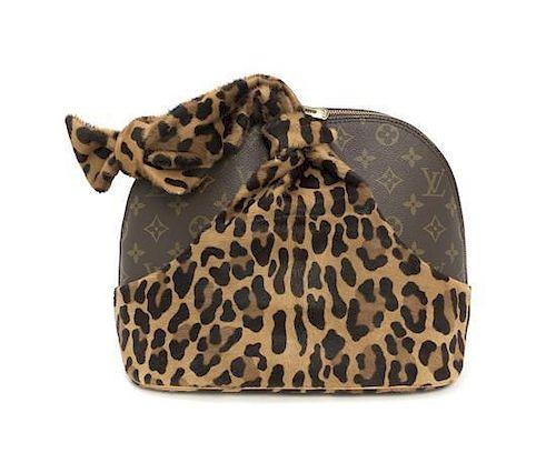 ca41274b9ea3 A Louis Vuitton Centenaire Monogram Canvas and Leopard Print Pony ...