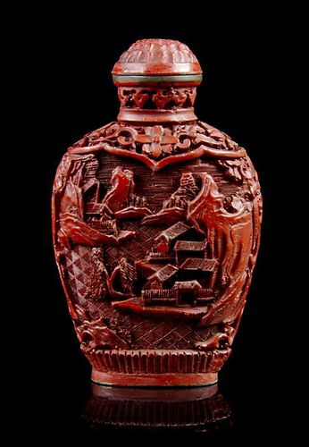 A Carved Cinnabar Lacquer Snuff Bottle, Height overall 3 inches.