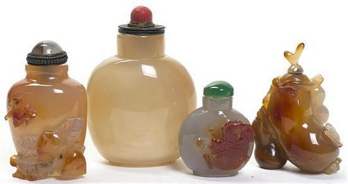 A Group of Four Agate Snuff Bottles, Height of tallest 3 1/16 inches.
