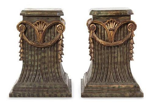 A Pair of Painted and Parcel Gilt Pedestals Height 31 x width 22 1/4 x depth 22 3/4 inches.