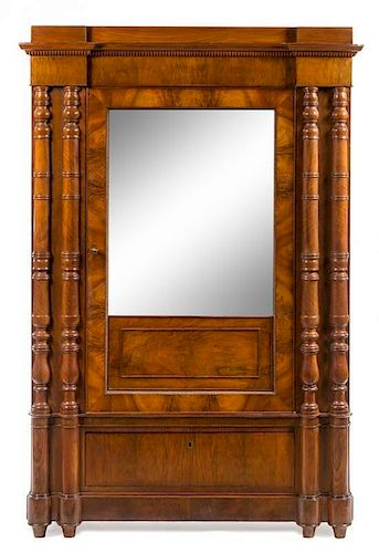 * An Italian Mahogany Armoire Height 78 x width 52 1/2 x depth 27 1/2 inches.