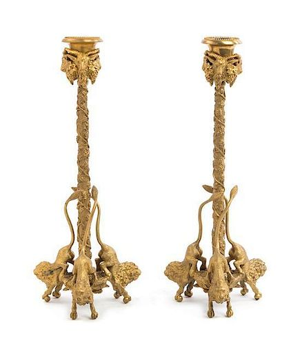 A Pair of Continental Gilt Bronze Candlesticks Height 12 1/2 inches.