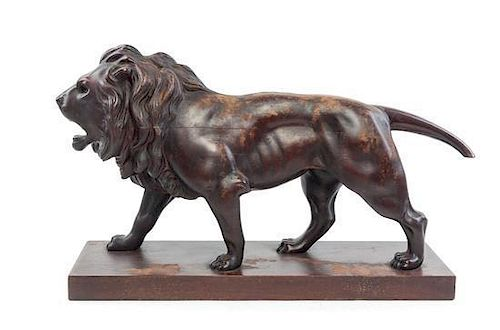 A Continental Carved Mahogany Figure Length 29 inches.