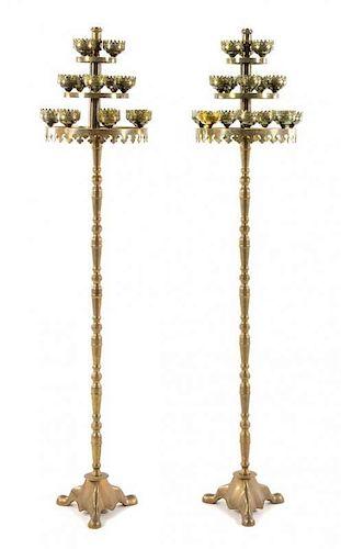 A Pair of Brass Fifteen-Light Torcheres Height 71 inches.