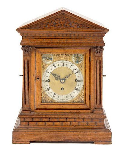 A German Oak Musical Mantel Clock Height 17 7/8 inches.