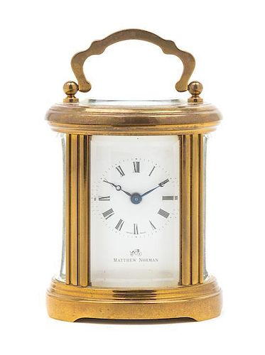 A Swiss Gilt Brass Carriage Clock Height 4 inches.