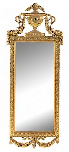 A Gustavian Giltwood Pier Mirror Height 68 1/2 x width 26 3/4 inches.