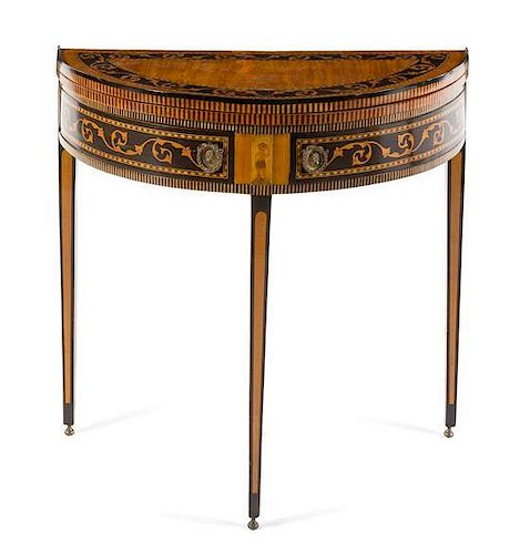 A Continental Marquetry Flip-Top Game Table Height 31 x width 32 x depth 16 inches (closed).
