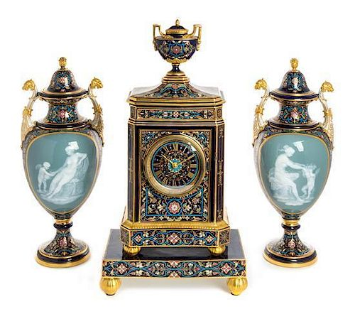 A Meissen Porcelain Pate-sur-Pate Four-Piece Clock Garniture Height of mantel clock with stand 19 7/8 inches.