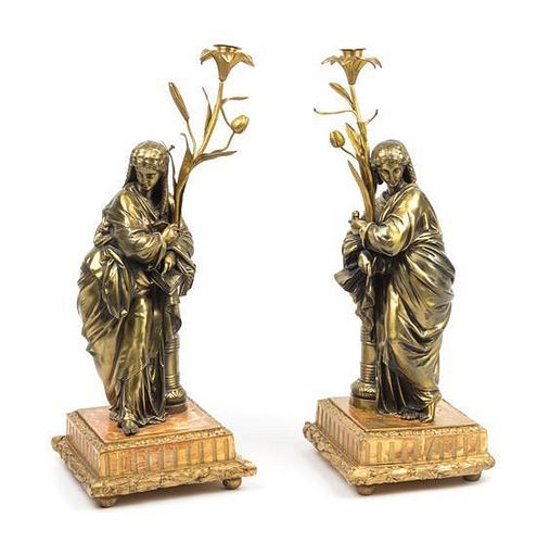 A Pair of Continental Gilt Bronze Figural Candlesticks Height 20 inches.
