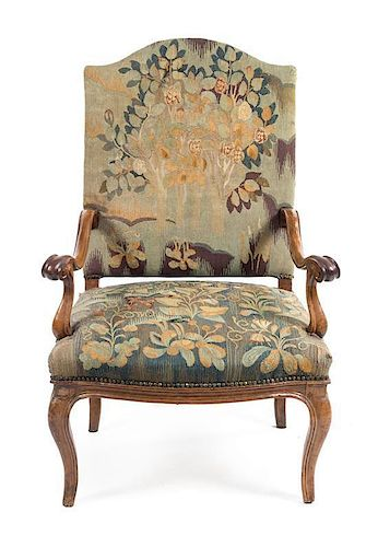 * A Regence Walnut Armchair Height 44 1/4 inches.