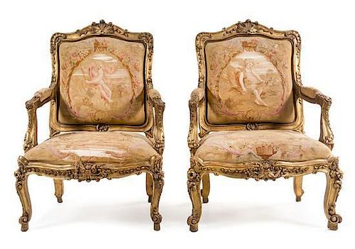 A Pair of Louis XV Style Giltwood Fauteuils Height 42 1/2 inches.