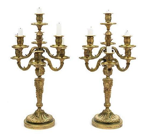 * A Pair of Louis XVI Style Gilt Bronze Seven-Light Candelabra Height 20 3/4 inches.