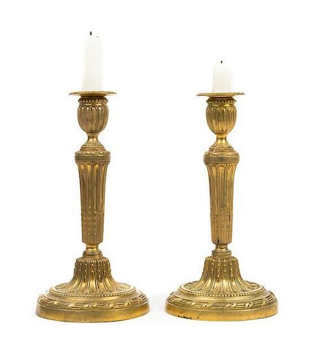 * A Pair of Louis XVI Style Gilt Bronze Candlesticks Height 10 3/4 inches.
