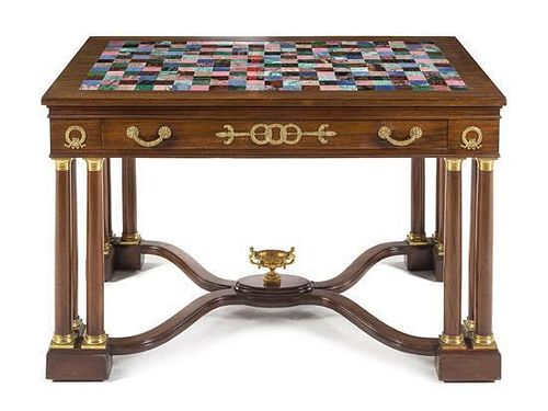 An Empire Style Gilt Bronze and Marble Mounted Mahogany Table Height 30 3/4 x width 48 x depth 30 inches.