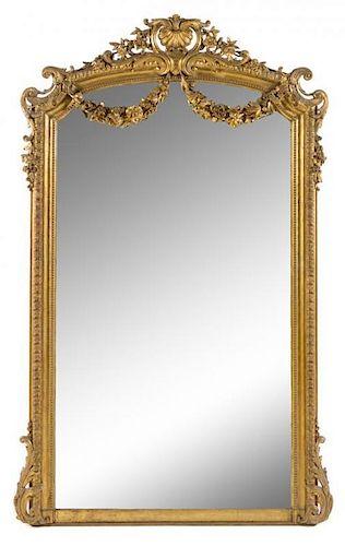 A Napoleon III Giltwood Overmantel Mirror Height 82 1/2 x width 51 inches.