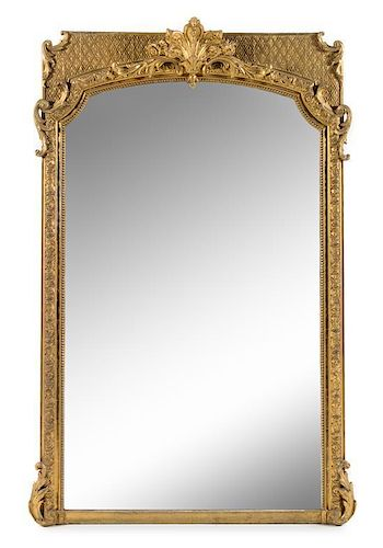 A Napoleon III Giltwood and Composition Mirror Height 75 x width 50 inches.