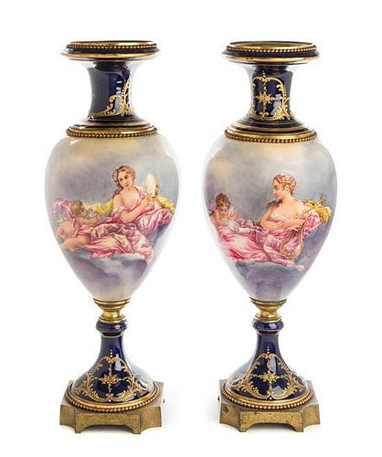 A Pair of Gilt Bronze Mounted Sevres Style Porcelain Urns Height 24 inches.