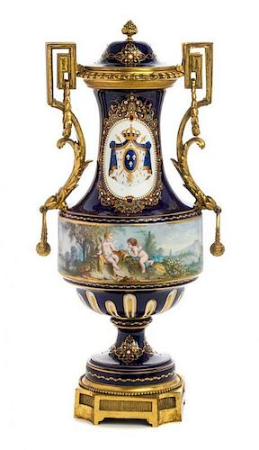 A Gilt Bronze Mounted Sevres Style Jeweled Porcelain Covered Urn Height 24 inches.