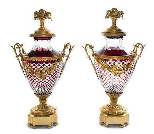 A Pair of Gilt Bronze Mounted Ruby Cut to Clear Glass Covered Urns Height 28 1/2 inches.