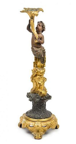 A French Gilt and Patinated Bronze Figural Candlestick Height 20 1/4 inches.