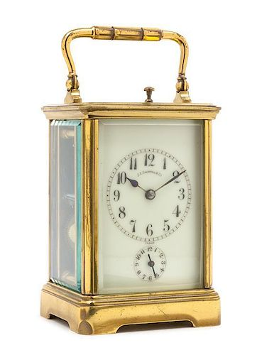 A French Gilt Brass Carriage Alarm Clock Height 6 3/4 inches.