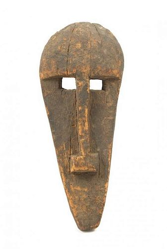 * An Igbo Wood Mask Height 15 1/4 inches.