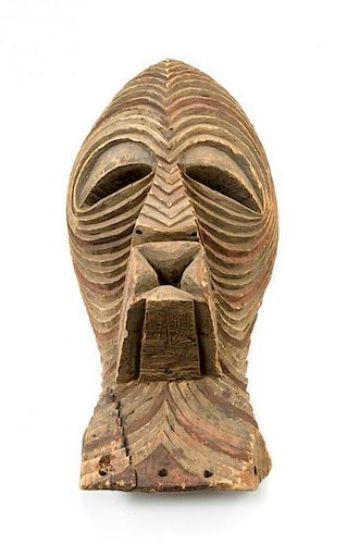 * A Kifwebe Carved and Painted Wood Mask Height 20 1/2 inches.