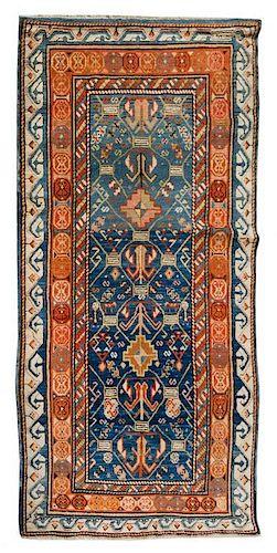 * A Caucasian Wool Rug 5 feet 10 inches x 3 feet 1 inch.
