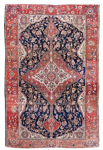 A Feraghan Sarouk Wool Rug 9 feet 11 inches x 6 feet 10 inches.