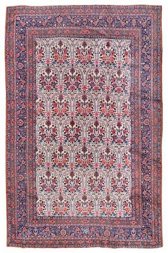 A Tabriz Wool Rug 8 feet 8 inches x 11 feet 7 inches.