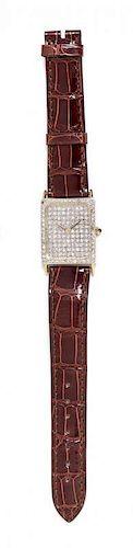A 14 Karat Yellow Gold and Diamond Wristwatch,