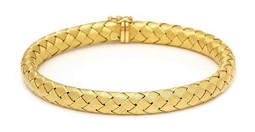 An 18 Karat Yellow Gold and Sapphire Basket Weave Bangle Bracelet, Roberto Coin, 15.80 dwts.