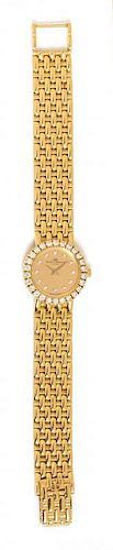 * An 18 Karat Yellow Gold and Diamond Wristwatch, Baume & Mercier, 31.75 dwts.
