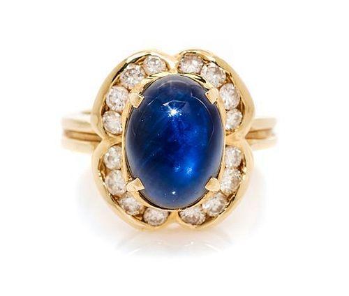 A 14 Karat Yellow Gold, Sapphire and Diamond Ring, 6.40 dwts.