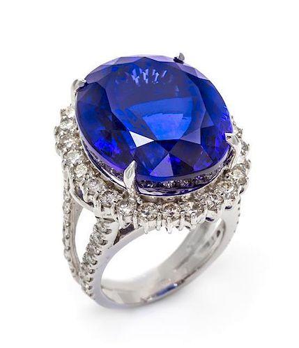 A 14 Karat White Gold, Tanzanite and Diamond Ring, 16.40 dwts.