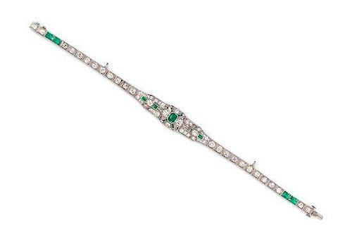 * An Art Deco Platinum, Emerald and Diamond Bracelet, 11.60 dwts.