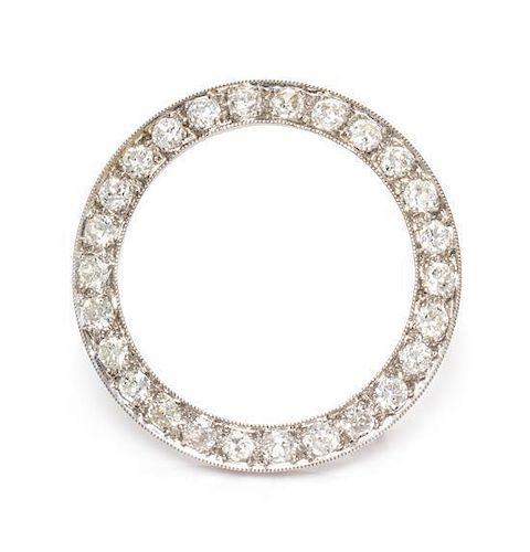 * A Platinum and Diamond Circle Brooch, 3.00 dwts.