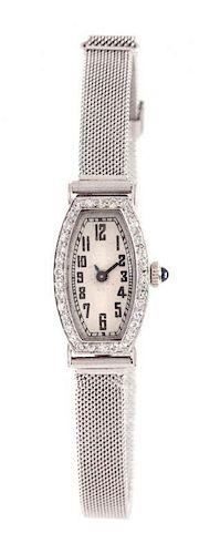An Art Deco Platinum and Diamond Wristwatch, 13.60 dwts.