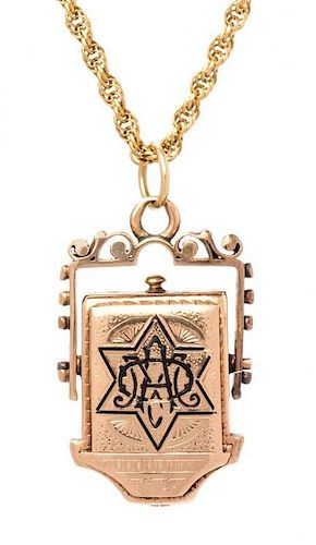 A Victorian 14 Karat Rose Gold and Enamel Mourning Pendant/Necklace, 7.20 dwts.