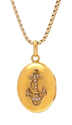 A Victorian Yellow Gold and Seed Pearl Locket and 14 Karat Yellow Gold Chain, 12.30 dwts.