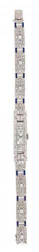 An 18 Karat White Gold, Platinum, Diamond and Synthetic Sapphire Wristwatch, 17.20 dwts.