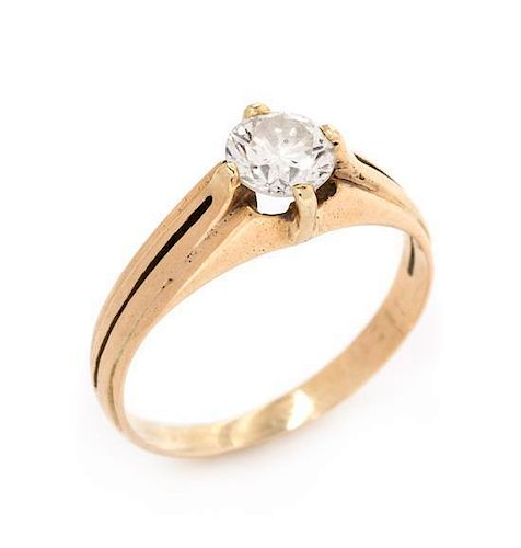 * A Yellow Gold and Diamond Solitaire Ring, 1.90 dwts.