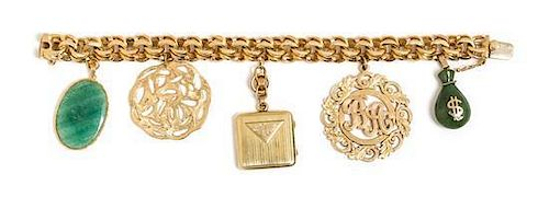 * A 14 Karat Yellow Gold Bracelet with Five Attached Charms, 60.10 dwts.