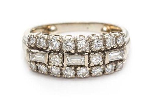 * A 14 Karat White Gold and Diamond Ring, 2.35 dwts.