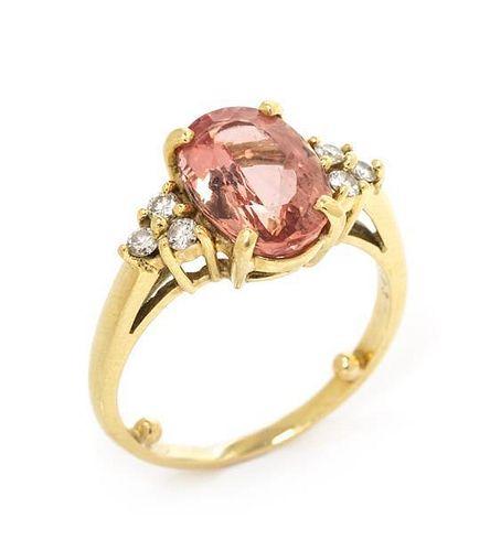 * An 18 Karat Yellow Gold, Topaz and Diamond Ring, 2.75 dwts.