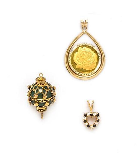 A Collection of Yellow Gold and Gemstone Pendants, 14.90 dwts.