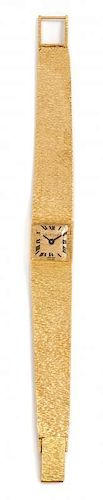 * An 18 Karat Yellow Gold Wristwatch, Bueche Girod, 35.20 dwts.