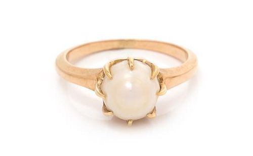 * A 14 Karat Rose Gold and Pearl Solitaire Ring, 2.00 dwts.