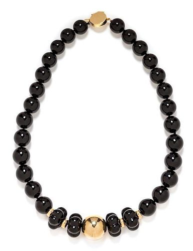 A 14 Karat Yellow Gold and Onyx Bead Necklace, 67.10 dwts.